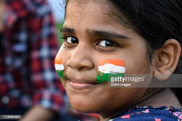 Indian flag colours painted on a kid's face during the occasion India celebrated its 74th Independence Day It is annually celebrated on 15th August...