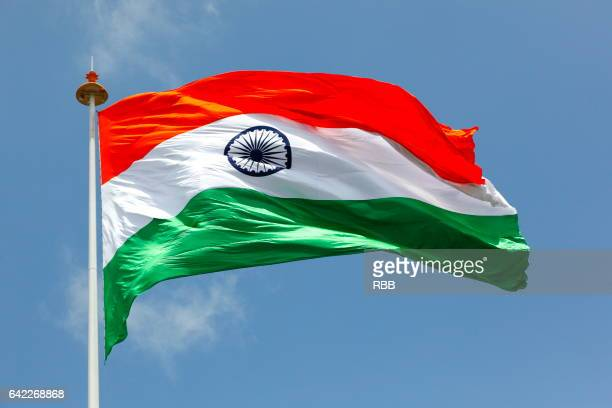 indian flag flying high - indian flag stock pictures, royalty-free photos & images