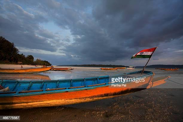Indian flag in a colorful boat, Vijay Nagar Beach