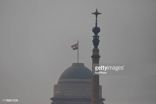Indian Flag is seen amid heavy smog in New Delhi india on 28 October 2019