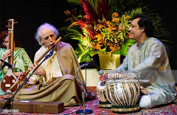 Indian flautist GS Sachdev plays a bansuri with Swapan Chaudhuri on tabla and Hallie Goodman on tanpura during a preperformance soundcheck before a...