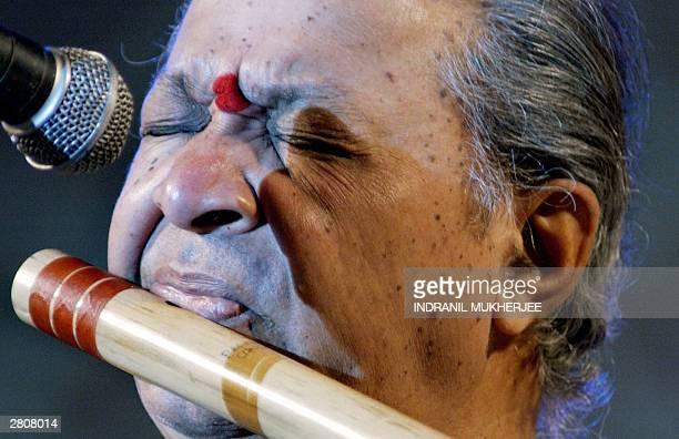 Indian flautist Pandit Hari Prasad Chaurasia plays the Bansuri during his live performance in Bangalore 12 December 2003 Chaurasia belonging to...