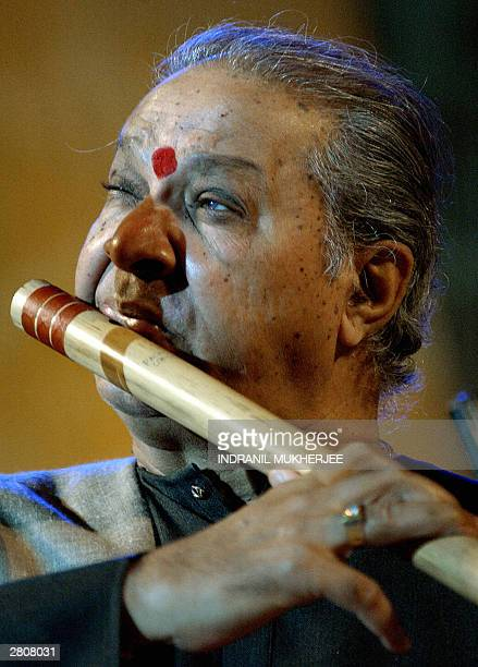 Indian flautist Pandit Hari Prasad Chaurasia plays the Bansuri during his live performance in Bangalore 12 December 2003 Chaurasia belonging to...