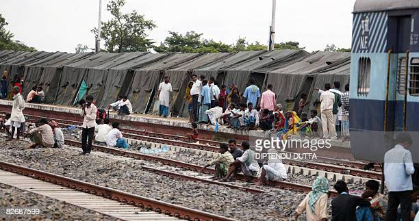 Indian floodaffected viilagers rest at a temporary flood relief camp set up at Bathna Railway station in Araria district some 480 km northeast of...