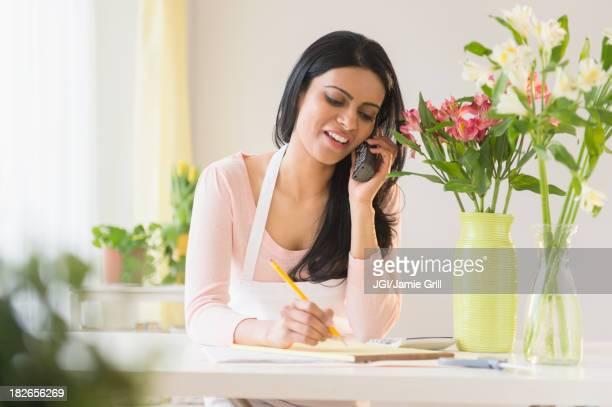Indian florist talking on telephone