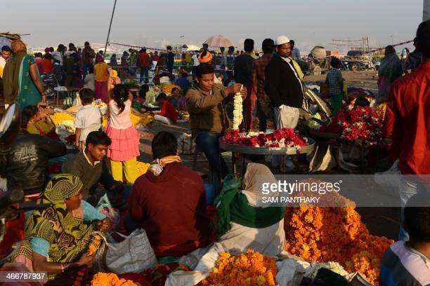 Indian flower vendors prepare garlands on the occasion of Basant Panchmi which marks the start of spring season in Ahmedabad on February 4 2014...
