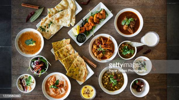 indian food background. - curry meal stock pictures, royalty-free photos & images
