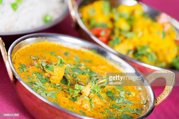 Indian food: butter chicken with basmati rice and aloo gobi
