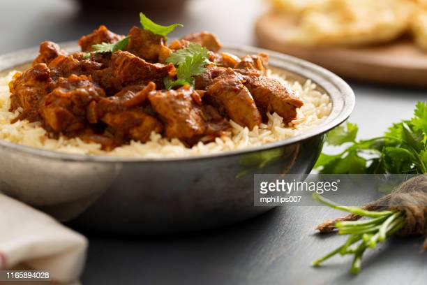 indian food chicken vindaloo curry over basmati rice - curry meal stock pictures, royalty-free photos & images