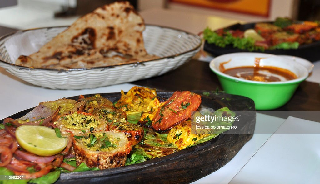 Indian food - paneer tikka and nan : Stock Photo