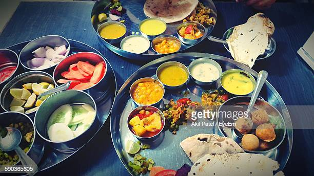 indian food served in plate on table - indian food stock photos and pictures