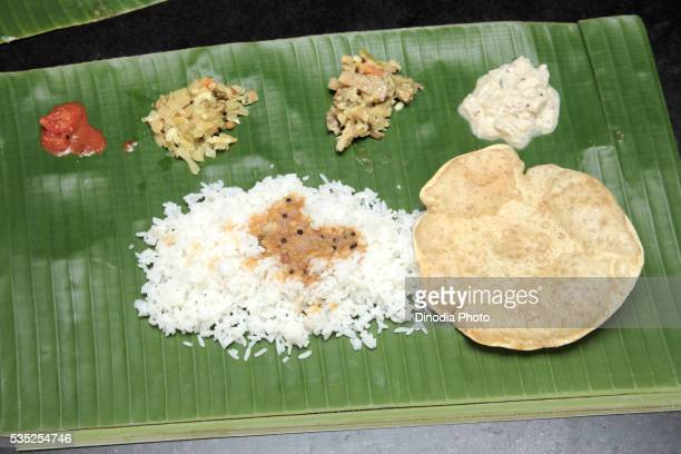 Indian food served on banana leaf cabbage and mixed vegetables in Kerala, India.