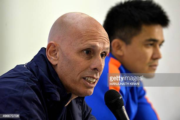 Indian football coach Stephen Constantine addresses a press conference by the Indian football team as footballer Sunil Chhetri looks on in Bangalore...