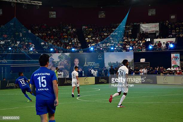Indian football legend Bhaichung Bhutia Indian striker Sunil Chhetri and Lenny Rodrigues at the exhibit football match organised in honour of French...