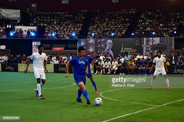 Indian football legend Bhaichung Bhutia takes a strike at the exhibit football match organised in honour of French football icon and Real Madrid...