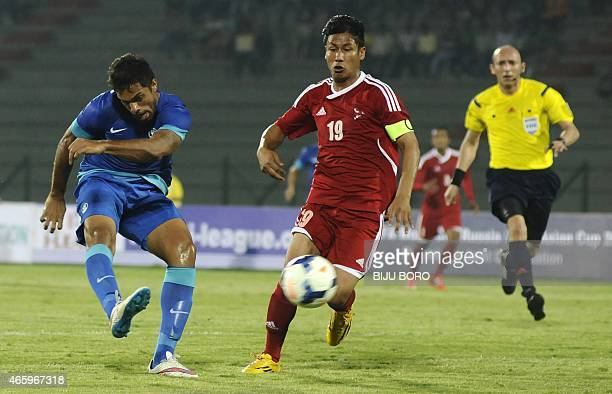 Indian football player Robin Singh and Nepalese football player Sagar Thapa vie for the ball during a qualifier match for the FIFA World Cup Russia...