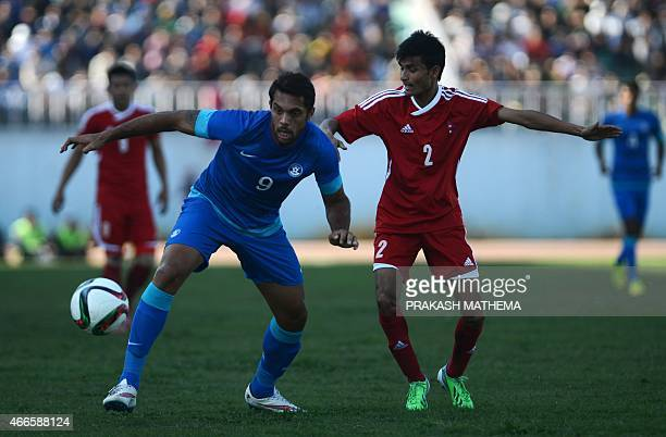 Indian football player Robin Singh and Nepal's Rabin Shrestha vie for the ball during a qualifier match for the FIFA World Cup Russia 2018 at Dasrath...