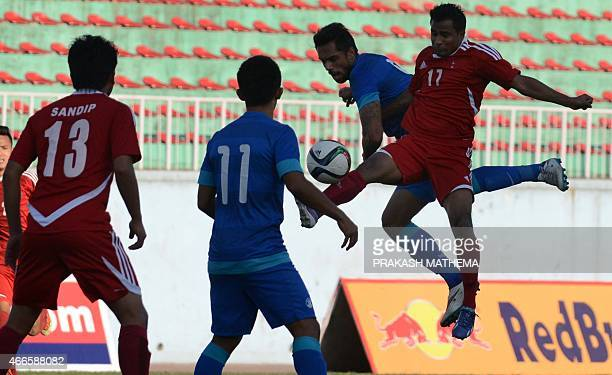Indian football player Robin Singh Nepal's Bhola vie for the ball during a qualifier match for the FIFA World Cup Russia 2018 at Dasrath Stadium in...