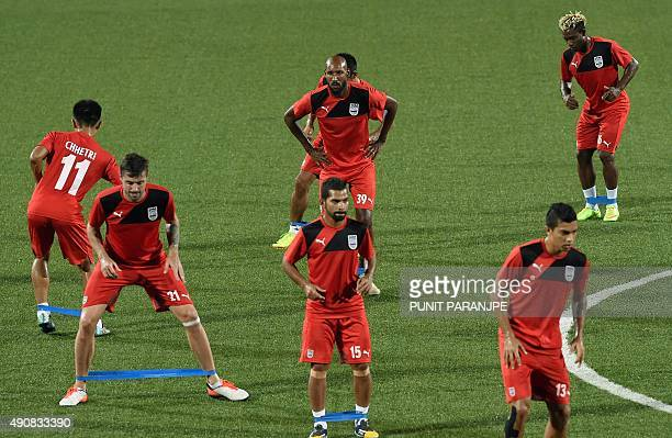 Indian football team Mumbai City FC player Nicolas Anelka warms up with team mates during a training session in Mumbai on October 1 2015 The second...