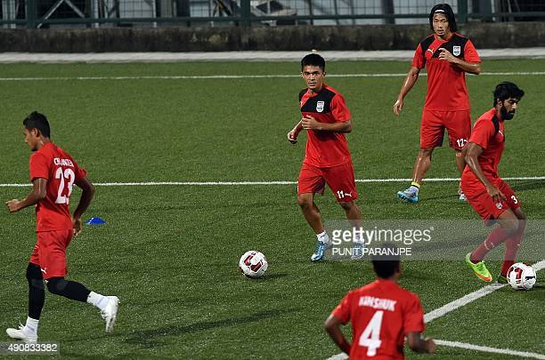 Indian football team Mumbai City FC player Sunil Chhetri warms up with teammates during a training session in Mumbai on October 1 2015 The second...
