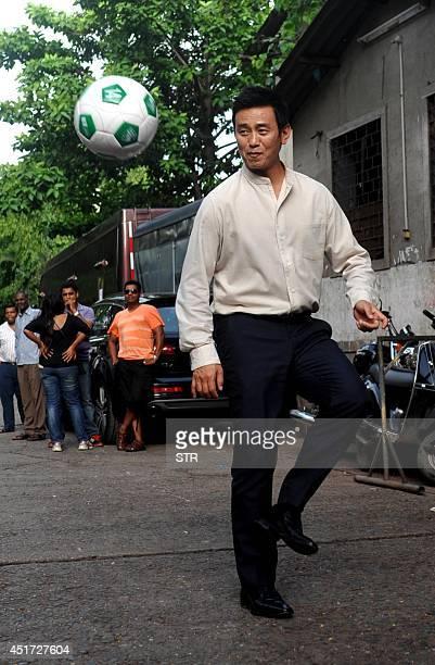 Indian footballer Bhaichung Bhutia poses during the Indias Biggest Football Hangout using Google light box technology in Mumbai on July 5 2014 AFP...