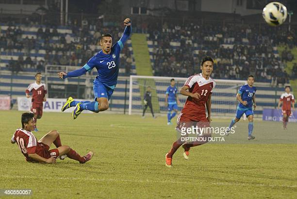 Indian footballer Robin Singh vies with Nepalese player Bikram Lama and Sagar Thapa during an international friendly between India and Nepal at...