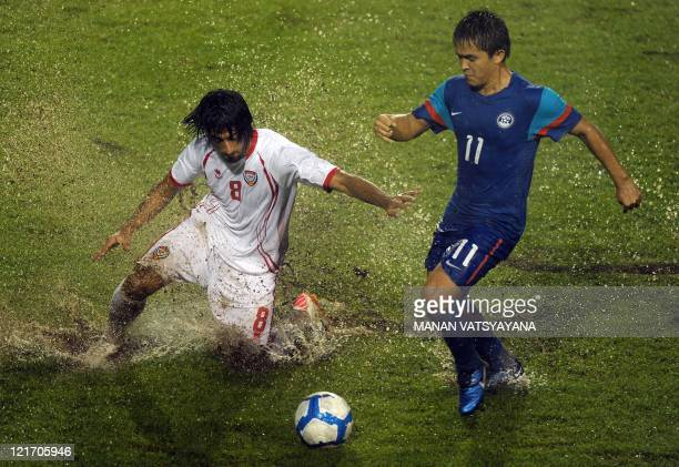Indian footballer Sunil Chhetri vies for the ball with Hamdan Al Kamali of UAE during their 2014 World Cup Asian zone Qualifying football match at...