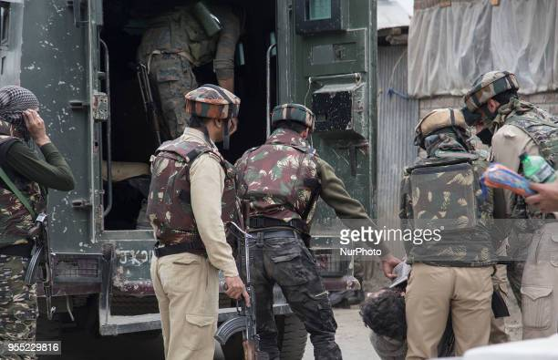 Indian forces carry the body of a rebel near the gunfight site Saturday May 5 2018 in Srinagar Indiancontrolled Kashmir Three rebels were killed in a...