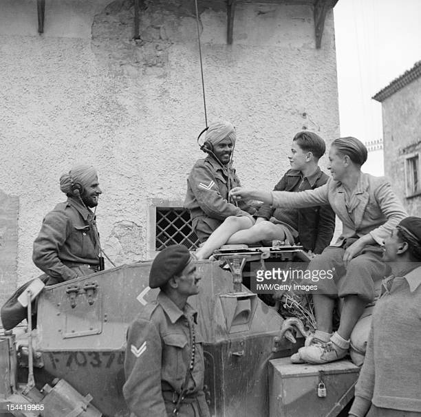 Indian Forces In Italy A scout car crew of 6th Duke of Connaught's Own Lancers Indian Armoured Corps chat with youngsters in San Felice during the...