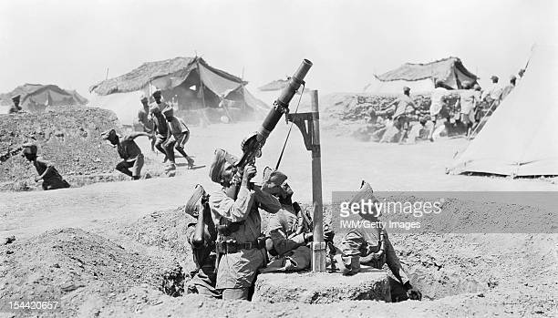 Indian Forces In Mesopotamia As other soldiers run for the cover of slit trenches an Indian Lewis gun team engage an enemy aircraft Mesopotamia 1918...