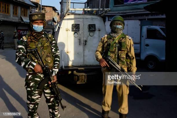 Indian forces stand alert during encounter in Batamaloo area of Srinagar Indian Administered Kashmir on 17 September 2020 Three Kashmiri millitants...