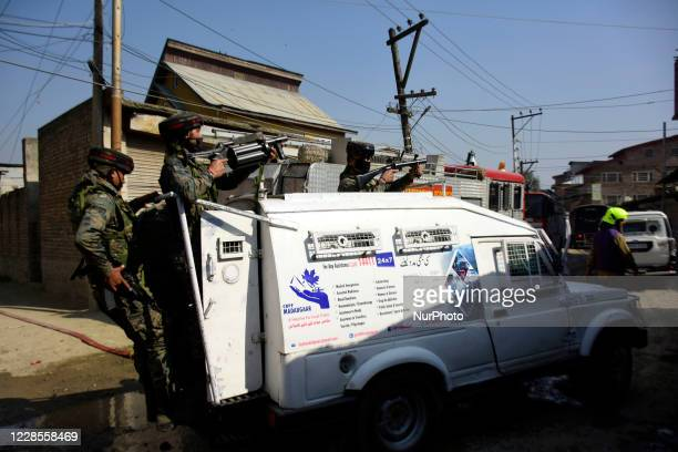 Indian forces takes position during clashes with Kashmiri protesters after the encounter ended in Batamaloo area of Srinagar Indian Administered...