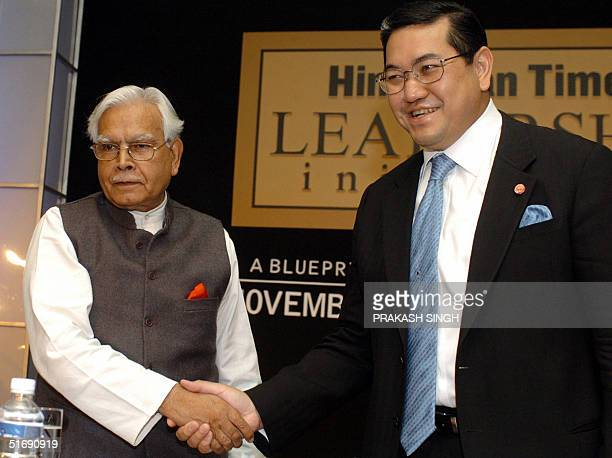 Indian Foreign Minister Natwar Singh and Thailand Foreign Minister Surakiart Sathirathai shake hands during a conference as part of the Hindustan...