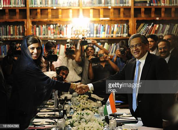 Indian Foreign Minister SM Krishna and his Pakistani counterpart Hina Rabbani Khar shake hands during a meeting in Islamabad on September 8 2012...