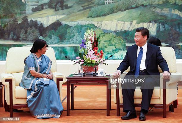 Indian Foreign Minister Sushma Swaraj and Chinese President Xi Jinping hold a meeting at the Great Hall of the People on February 2 2015 in Beijing...