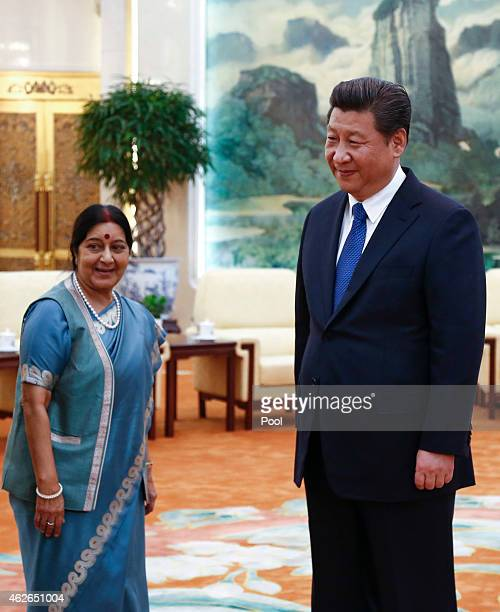 Indian Foreign Minister Sushma Swaraj and Chinese President Xi Jinping wait for arriving members of the Indian delegation during a meeting at the...