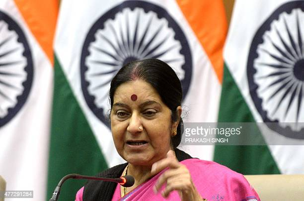 Indian Foreign Minister Sushma Swaraj gestures as she addresses media representatives in New Delhi on June 16 ahead of flagging off a batch of...