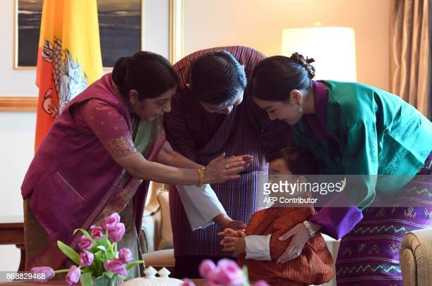 Indian Foreign Minister Sushma Swaraj gives her blessings to Bhutan's prince Jigme Namgyel Wangchuck as Bhutans King Jigme Khesar Namgyel Wangchuck...