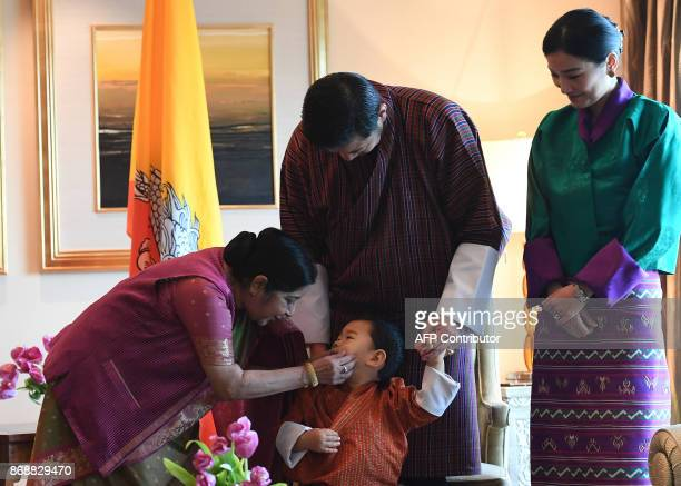 Indian Foreign Minister Sushma Swaraj interacts with Bhutan's prince Jigme Namgyel Wangchuck as Bhutans King Jigme Khesar Namgyel Wangchuck and Queen...
