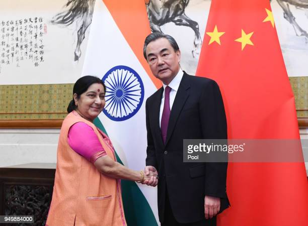 Indian Foreign Minister Sushma Swaraj shakes hands with Chinese Forein Minister Wang Yi have a meeting at the Diaoyutai State Guest House on April 22...