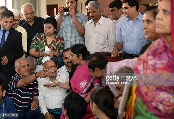 Indian Foreign Minister Sushma Swaraj speaks with pilgrims in New Delhi on June 16 ahead of flagging them off on their journey to Mount Kailash The...