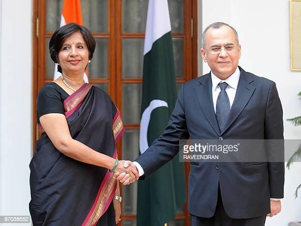 Indian Foreign Secretary Nirupama Rao shakes hands with visiting Pakistani Foreign Secretary Salman Bashir in New Delhi on February 25 2010 India and...