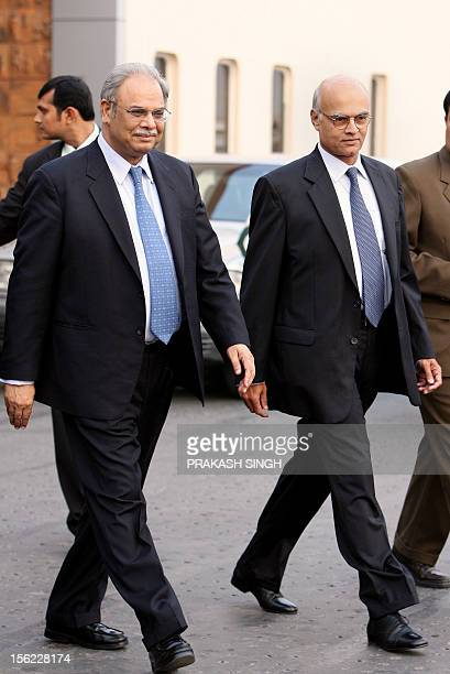 Indian Foreign Secretary Shiv Shankar Menon walks with his Pakistani counterpart Riaz Mohammad Khan upon the latter's arrival at the international...