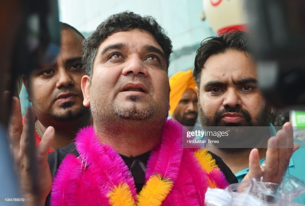Indian former prisoner Sandeep walks out of the international airport on July 24 2018 in Amritsar India The Sharjah Police had arrested Sandeep for...