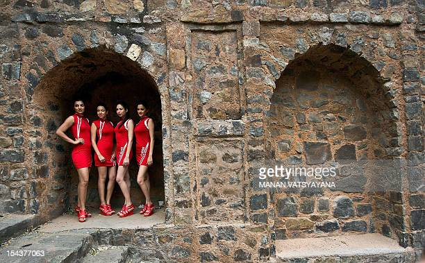 Indian Formula One grid girls pose during a promotional event at the Agrasen ki Baoli in New Delhi on October 19, 2012. The 2012 Formula One Indian...