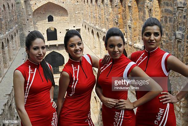 Indian Formula One grid girls pose during a promotional event at the Agrasen ki Baoli on October 19, 2012 in New Delhi, India. The 2012 Formula One...