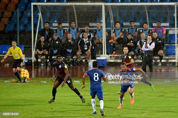 Indian forward Robin Singh and midfielder Cavin Peter Lobo take the ball during the the Asia Group D FIFA World Cup 2018 qualifying football match...