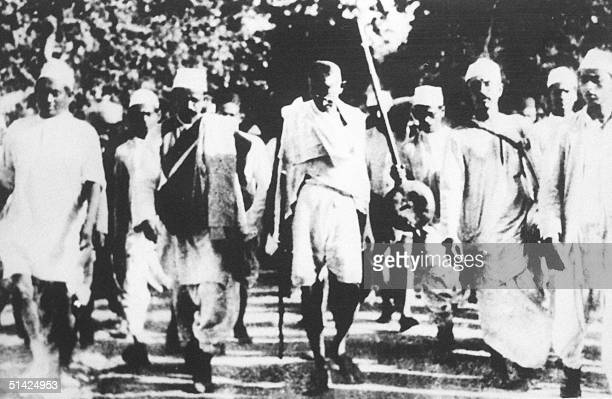 Indian freedom fighter Mohandas Karamchand Gandhi is pictured with his followers in this March 1930 photo during the famous salt march to Dandi...