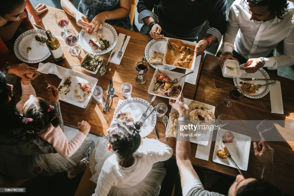 Indian Friends and Family Share Traditional Meal Together : Stock Photo