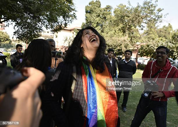 Indian gay rights activist Amalina Dave smiles outside the Supreme Court as it agreed to refer a curative petition challenging Section 377 of the...